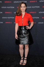 Emilia Clarke was sporty-chic in a red zip-up knit top at the Louis Vuitton Series 2 exhibition.