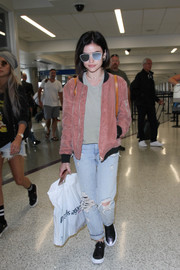 Lucy Hale was tough and trendy in a pink bomber jacket while making her way through LAX.