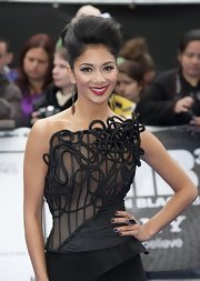 Nicole Scherzinger accessorized her look with a smoky quartz cocktail ring featuring pave diamonds.