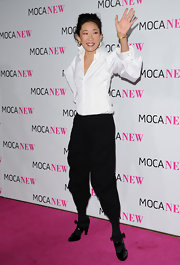 Strappy patent pumps rounded out Sandra Oh's look.