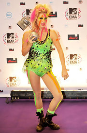 Kesha tries to follow Lady Gaga's trend with this eccentric leotard. She paired this neon look with black combat boots.