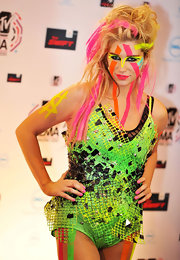 Kesha was a colorful sensation at the MTV Europe Awards. She topped her messy 'do with streaks of neon highlights.