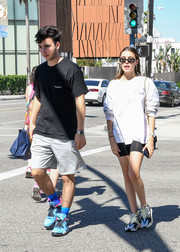 Madison Beer dressed down in a white sweatshirt for a day out in LA.