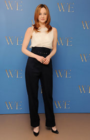 Andrea Riseborough hid her slender shape in a pair of black high-waisted pants.