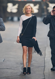 Malin Akerman paired her dress with simple black peep-toes booties.