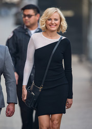 Malin Akerman headed to 'Jimmy Kimmel Live' carrying a chic black cross-body bag.