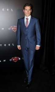 Henry Cavill wore this navy, three-piece, peak-lapeled suit to the premiere of the 'Man of Steel' premiere in Australia.