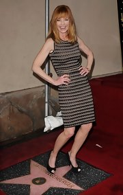 Marg paired her sheath dress with black peep-toe pumps.