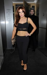 Maria Fowler went for a night out looking scandalous in a black crop-top and slacks.
