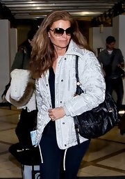 Maria Shriver look ready for the snow with this silver down jacket.