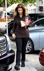 Maria Shriver kept a low profile in black skinny  jeans and a brown sweater.