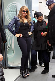 "Mariah is camera ready looking great in all black with black ""Raquel"" floating lens sunglasses."