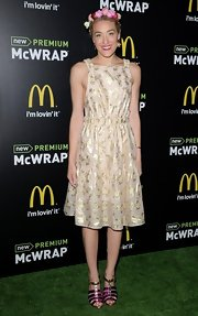 Mia Moretti looked like a little flower child with this fun and flirty metallic frock.