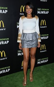 Tatyana Ali opted for a futuristic look when she chose this frock with a white top with gold mesh and a silver peplum skirt.