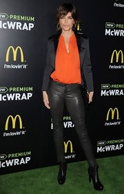 Lisa Rinna chose a satin blazer to pair over her tangerine top for a mix of different textures.