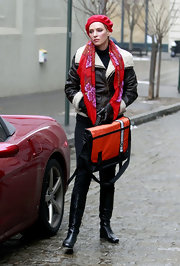 Uma Thurman was spotted on the set of 'Smash' in black leather flat boots.