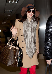 Katharine McPhee upped the glam factor of her travel attire with a luxe monogrammed tote.