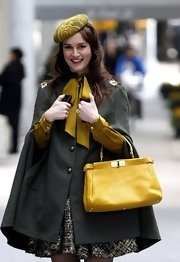 Leighton Meester topped off her darling 'Gossip Girl' look with a chartreuse pillbox hat.