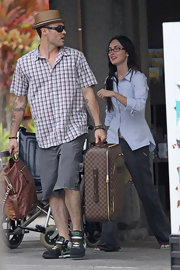 Megan Fox and Brian Austin Green board a Hawaiian flight back to LA. They toted around a designer travel rollerboard.