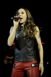 Mel C looked edgy yet smart in a black leather tank top and red pants during a performance at Shepherd's Bush Empire.