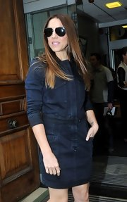 Mel C was casual yet classy in a dark blue denim dress during a visit to BBC.