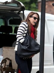 Mel C's black leather hobo bag looked perfectly appropriate for a busy day.