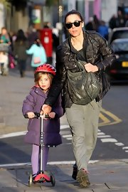 Mel C took a stroll with her daughter carrying a gray hobo bag.