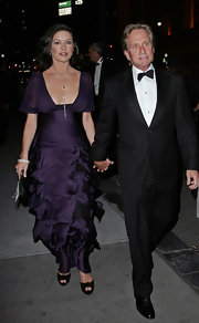 Catherine Zeta Jones looked sophisticated in a purple chiffon gown featuring a tiered skirt and ruched waist.