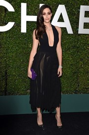 For a burst of color, Emmy Rossum carried a purple box clutch, also by Michael Kors.