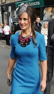 Pippa Middleton chose this gray hat that features a bow and netting for her look while out in Northumberland.