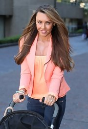 Michelle Heaton combined pastel shades as she wore a coral blazer on top of her yellow tank while out at London Studios.