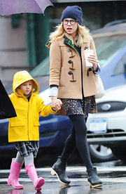 Michelle kept warm in a tan trench coat and beanie while in Brooklyn with daughter Matilda.