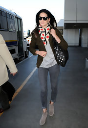Michelle tosses on a patterned scarf to make this look ultra stylish.