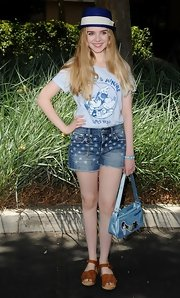 Darcy rocked a pair of star-print denim shorts while at the launch of the 'Mickey Through the Decades Collection.'