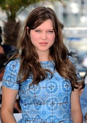 Lea Seydoux styled her hair in loose curls for the photo call for 'Midnight in Paris.'