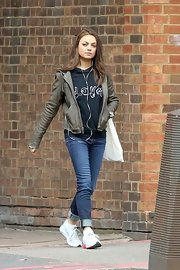Mila Kunis rocked some killer street style while out in London when she wore this gray leather jacket paired over a cool graphic hoodie.