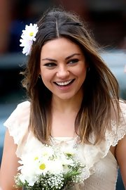 Mila Kunis wore her long straight hair with subtle twists and adorable daisies while filming a scene for her new movie.