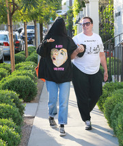 Miley Cyrus sealed off her casual look with a pair of Converse sneakers.