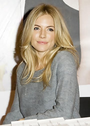 Sienna Miller donned center part tresses to the launch of her newest Twenty8Twelve collection.