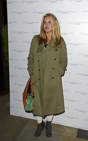 Caggie Dunlop attended Millie MacKintosh's product launch wearing a double-breasted trench.