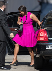 Mindy Kaling headed to 'Kimmel' looking bright and cute in a magenta cocktail dress.