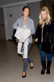 Minka Kelly strolled through LAX in fetching black ballet pumps lined with brown leather trim.