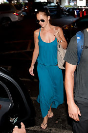 Minka Kelly made a dash for a limo at LAX airport wearing a long cotton turquoise sundress with spaghetti straps.