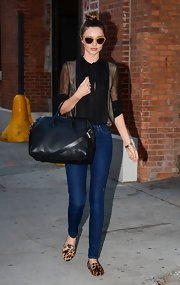 Black button-down blouses are Miranda Kerr's street style specialty—especially ones of the sheer variety!