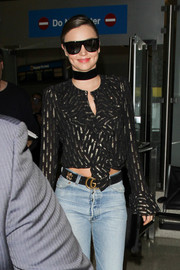 Miranda Kerr landed at LAX rocking a pair of bold Saint Laurent shades.