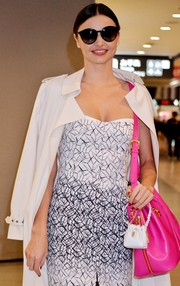 Miranda Kerr hid her eyes behind a pair of oversized Stella McCartney sunnies as she landed at Narita Airport.