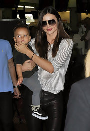 Miranda Kerr played down the inherent sexiness of her leather pants with a striped T-shirt.