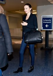 Miranda Kerr stepped out in a pair of black ankle boots.