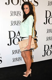 Megan Gale attended the David Jones fashion launch carrying an oversized nude leather clutch.