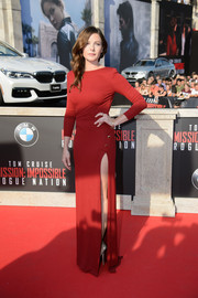 Rebecca Ferguson donned a long-sleeve red Elie Saab gown, given a sexy boost with a hip-grazing slit, for the 'Mission: Impossible - Rogue Nation' premiere in Vienna.